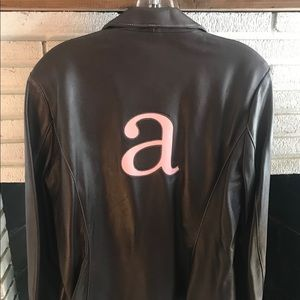 chocolate brown leather blazer with pink a on back